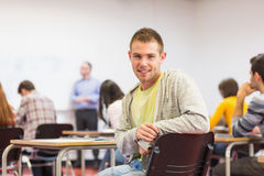 Male with blurred teachers students in classroom Stock Photography