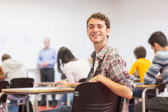 Male with blurred teachers students in classroom Royalty Free Stock Image
