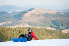 Male boarder on his snowboard at winer resort Stock Image