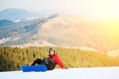 Male boarder on his snowboard at winer resort Stock Photo