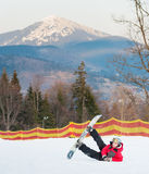 Male boarder on his snowboard at winer resort Royalty Free Stock Photo