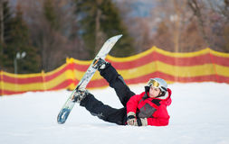 Male boarder on his snowboard at winer resort Stock Images