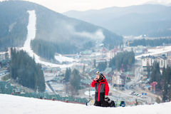 Male boarder on his snowboard at winer resort Royalty Free Stock Images