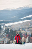 Male boarder on his snowboard at winer resort Royalty Free Stock Image