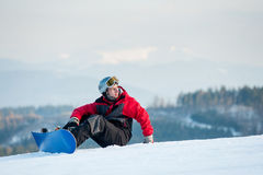 Male boarder on his snowboard at winer resort Royalty Free Stock Photos