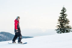 Male boarder on his snowboard at winer resort Stock Photos