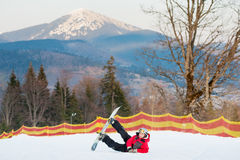 Male boarder on his snowboard at winer resort Royalty Free Stock Photography