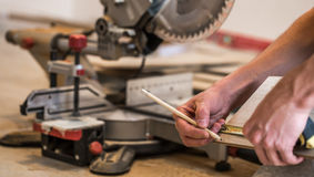 male boards, and miter saw Royalty Free Stock Image