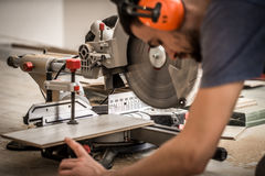Male boards, and miter saw Stock Image
