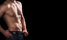 Male body on black background with copy space. Close-up of perfect male body isolated on black background with copy space Royalty Free Stock Images