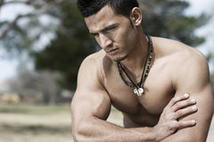 Male Body Builder. Muscular and attractive, unshaved man, a real troublemaker Stock Photography