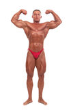 Male body builder demonstrating pose, isolated Royalty Free Stock Image