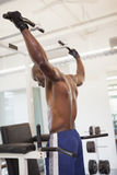 Male body builder doing pull ups at the gym Royalty Free Stock Images