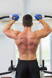 Male body builder doing pull ups at the gym Stock Photos