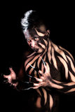 Male with body paint and claws Stock Image