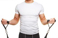 Male body in white shirt. With expander. Isolated on white Royalty Free Stock Photo