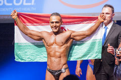 Male bodybuilder celebrates his championship victory on stage Royalty Free Stock Image