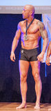 Male bodybuilder celebrates his championship victory on stage Stock Image