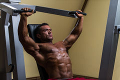 Male bodybuilder doing heavy weight exercise for upper chest Royalty Free Stock Photo