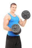 Male bodybuilder exercising with barbells Stock Photography