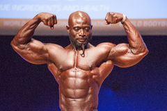 Male bodybuilder flexes his muscles and shows his best physique Stock Photo