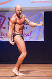 Male bodybuilder flexes his muscles and shows his best physique Royalty Free Stock Image