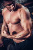 Male bodybuilder flexing his muscles Stock Image