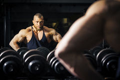 A male bodybuilder in front of a mirror royalty free stock photo