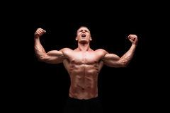 Male bodybuilder gesturing happiness Royalty Free Stock Image