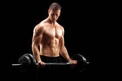 Male bodybuilder holding a barbell Stock Photos