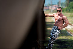 Male Bodybuilder Holding On To Train Stock Photography