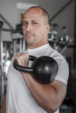 Male bodybuilder with kettlebell Royalty Free Stock Images