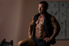 Male bodybuilder posing in black shirt without sleeves Stock Photo