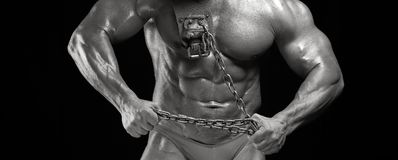 Male bodybuilder with relief muscular body. Black and white image of male abdominal muscles. Muscular high level bodybuilder with perfect trained body posing Royalty Free Stock Photo