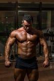 Male bodybuilder showing his body. Male body builder showing his body Stock Photography