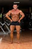 Male bodybuilder showing his body. Male body builder showing his body Royalty Free Stock Photos