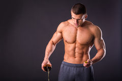 Male bodybuilder shows that beer is bad Stock Photography