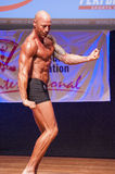 Male bodybuilder shows his best at championship on stage Royalty Free Stock Photography
