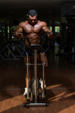 Male bodybuilder using the elliptical machine Stock Image
