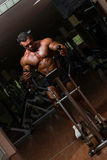 Male bodybuilder using the elliptical machine Royalty Free Stock Image