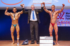 Male bodybuilders celebrate their championship victory with offi Royalty Free Stock Photography