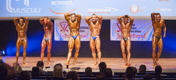 Male bodybuilders flex their muscles and show their best physiqu Stock Images