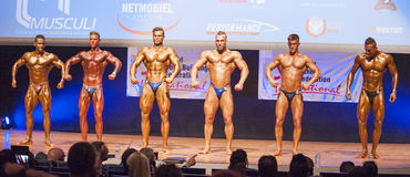Male bodybuilders flex their muscles and show their best physiqu. MAASTRICHT, THE NETHERLANDS - OCTOBER 25, 2015: Male bodybuilders Ali Rezah from Iran with Stock Photos