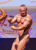 Male bodybuilders flex their muscles and show their best physiqu Royalty Free Stock Photo