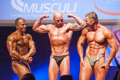 Male bodybuilders flex their muscles and show their best physiqu Stock Photo