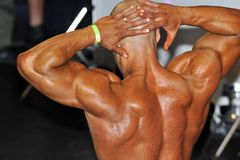 Male bodybuilding contestant showing his best back pose Royalty Free Stock Photo