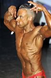 Male bodybuilding contestant showing his best. ROOSENDAAL, THE NETHERLANDS - OCTOBER 19, 2014. Male bodybuilders showing their best at the bodybuilding and Stock Images