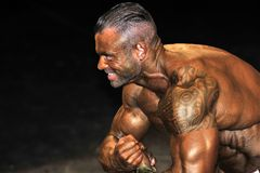 Male bodybuilding contestant showing his best. ROOSENDAAL, THE NETHERLANDS - OCTOBER 19, 2014. Walters Open Dutch Championship 2014 - category bodybuilding and Stock Photos
