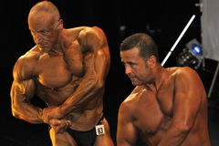 Male bodybuilding contestant showing his chest pose. ROOSENDAAL, THE NETHERLANDS - OCTOBER 19, 2014. Male bodybuilders showing their best at the bodybuilding and Royalty Free Stock Image