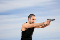 Male bodyguard with a gun Stock Image